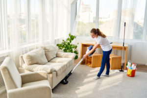 Is it better to dust or vacuum first