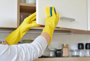 How do you clean grease and grime off kitchen cabinets